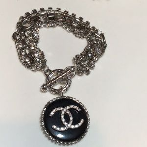 Large Fashion Designer black bracelet.